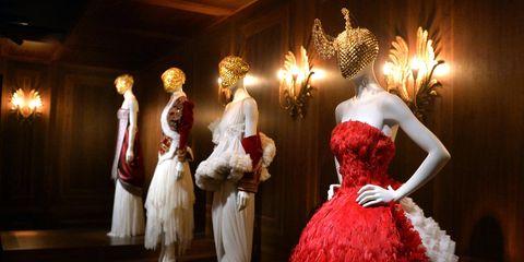 Lighting, Costume design, Dress, Fashion, Costume accessory, Costume, Fur, Light fixture, Gown, Performance art,