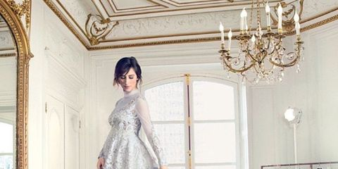 Arm, Trousers, Textile, Dress, Formal wear, Style, Bridal clothing, Gown, Light fixture, Ceiling,