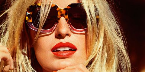 Eyewear, Vision care, Lip, Mouth, Finger, Hairstyle, Sunglasses, Hand, Fashion accessory, Earrings,