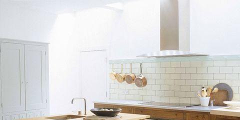 Furniture, Room, Countertop, Kitchen, Property, Interior design, Tile, Table, Cabinetry, Floor,