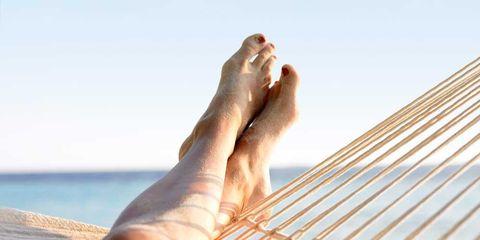 Finger, Skin, People in nature, Hammock, Summer, Nail, Toe, Tan, Sunlight, Wrist,