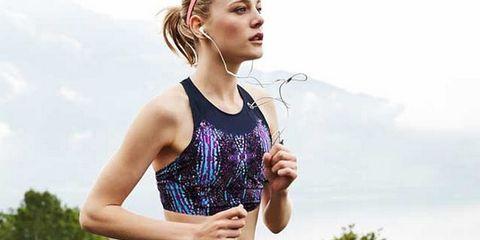 Sports uniform, Sportswear, Human leg, Recreation, Shoe, Sleeveless shirt, Running, Playing sports, Athlete, Competition event,