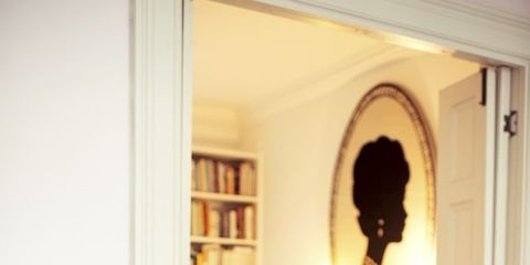 Room, Interior design, Living room, Couch, Furniture, Shelf, Interior design, Sitting, Home, Black hair,