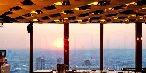 Table, Furniture, Real estate, Amber, Glass, Orange, Interior design, Apartment, Restaurant, Evening,