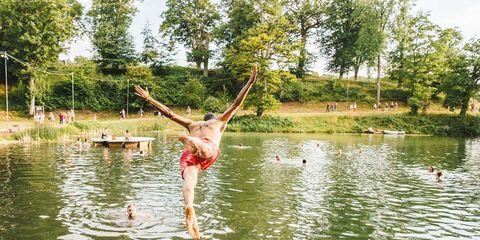 People in nature, Barefoot, Pond, Lake, Performance art, Physical fitness, Acrobatics, Balance, Swimwear, Reservoir,