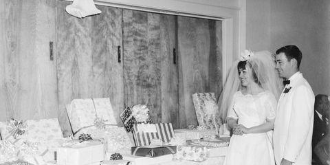 Trousers, Room, Dress, Bridal clothing, Coat, Photograph, White, Bridal veil, Interior design, Formal wear,