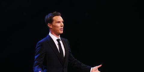 Dress shirt, Collar, Suit trousers, Hand, Coat, Suit, Outerwear, Standing, Formal wear, Blazer,