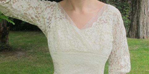 Clothing, Green, Sleeve, Shoulder, Dress, Textile, Joint, Wedding dress, Bridal clothing, Formal wear,