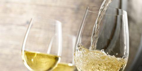 Drinkware, Glass, Stemware, Yellow, Wine glass, Barware, Drink, Alcoholic beverage, Fluid, Tableware,