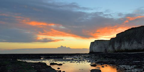 Coastal and oceanic landforms, Sky, Cloud, Sunset, Dusk, Natural landscape, Rock, Coast, Sunrise, Horizon,