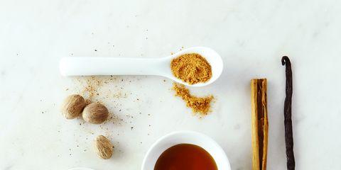 Brown, Ingredient, Serveware, Spice, Amber, Orange, Liquid, Star anise, Cinnamon, Cup,