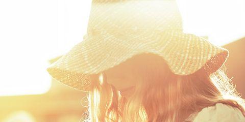 Hat, Sun hat, Headgear, Long hair, Sunlight, Beige, Waist, Fedora, Peach, Costume accessory,