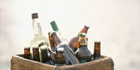 Glass bottle, Brown, Bottle, Alcohol, Alcoholic beverage, Drink, Basket, Home accessories, Wicker, Bottle cap,