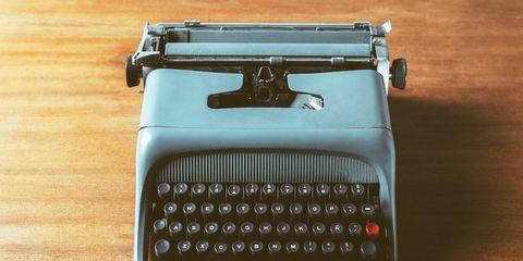 Typewriter, Office equipment, Text, Space bar, Line, Office supplies, Font, Machine, Black, Technology,
