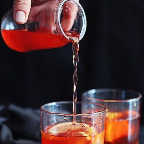 Liquid, Fluid, Glass, Alcoholic beverage, Drink, Red, Ingredient, Distilled beverage, Drinkware, Classic cocktail,