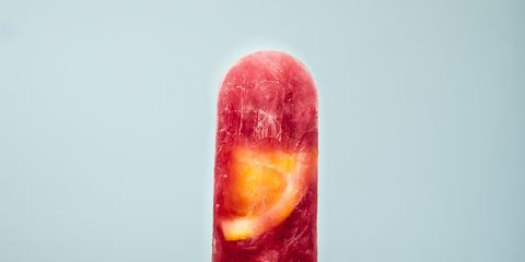 Finger, Food, Ice pop, Ingredient, Amber, Colorfulness, Fast food, Ice cream bar, Candy, Thumb,