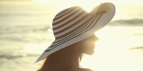 Hat, Brown, Hairstyle, Skin, People in nature, Summer, Sunlight, Headgear, Light, Beauty,