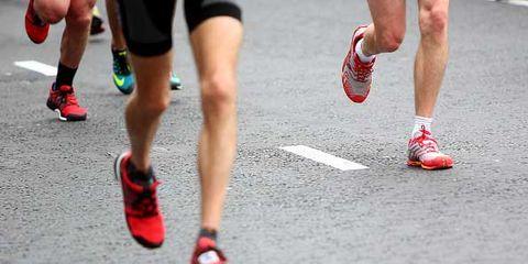 Footwear, Leg, Shoe, Human leg, Athletic shoe, Red, Joint, Sportswear, Shorts, Muscle,