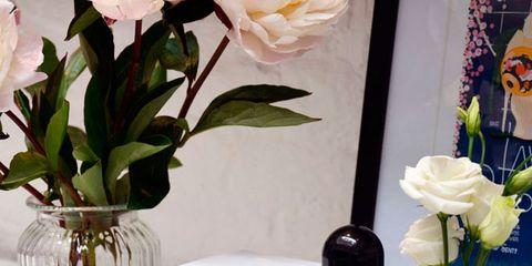 Yellow, Flower, Glass bottle, Bottle, Perfume, Plant, Artificial flower, Centrepiece, Material property, Vase,
