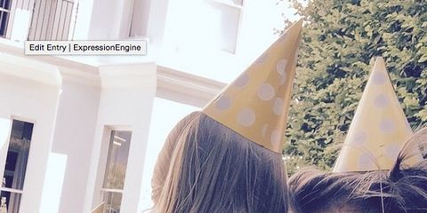Party hat, Costume accessory, Cone, Long hair, Flag, Costume hat, Party supply, Costume, Love,