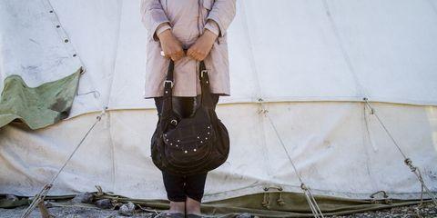 Textile, Outerwear, Bag, Street fashion, Shoulder bag, Belt, Pocket, Tarpaulin, Handbag, Foot,