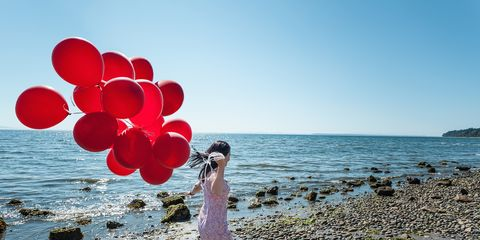 Body of water, Dress, Water, Coastal and oceanic landforms, People in nature, Summer, Shore, Balloon, People on beach, Ocean,