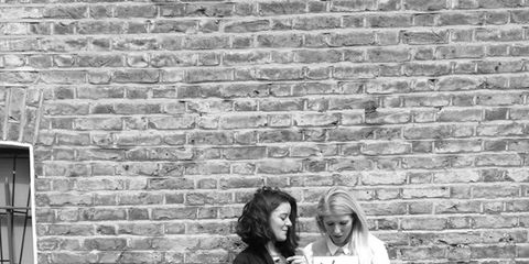 Brick, Monochrome, Wall, Photograph, Outerwear, Monochrome photography, White, Standing, Style, Black-and-white,