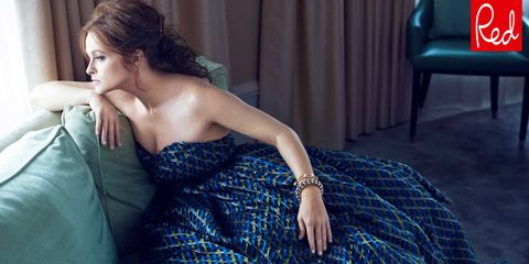 Dress, Strapless dress, Comfort, Sitting, Couch, Black hair, Teal, Day dress, One-piece garment, Electric blue,