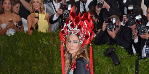 Red, Style, Carpet, Costume accessory, Headgear, Headpiece, Hair accessory, Tradition, Costume, Costume design,