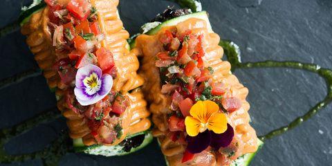 Cuisine, Orange, Dish, Garnish, Culinary art, Recipe, Artificial flower, Floral design, Cut flowers, Flower Arranging,