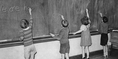Footwear, Standing, Child, Style, Interaction, Shorts, Blackboard, Class, Gesture, Monochrome,