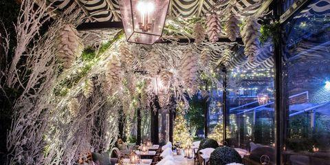 Lighting, Furniture, Table, Light fixture, Ceiling, Outdoor table, Outdoor furniture, Decoration, Restaurant, Chandelier,
