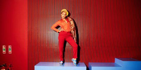 Red, Human leg, Stage, Wood flooring, Laminate flooring, Fire extinguisher, Talent show, Flowerpot, Fashion design, Houseplant,
