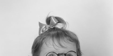 Eyewear, Child, Baby & toddler clothing, Reading, Portrait photography, Paper, Day dress, Portrait, Hair accessory, Child model,