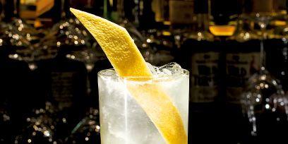 Yellow, Drink, Liquid, Glass, Fluid, Cocktail, Alcoholic beverage, Tableware, Lemon, Classic cocktail,