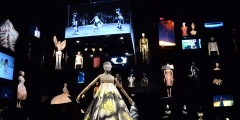 Dress, Victorian fashion, Display device, Costume design, Gown, hoopskirt, Haute couture, Fashion design, Stage, Opera,