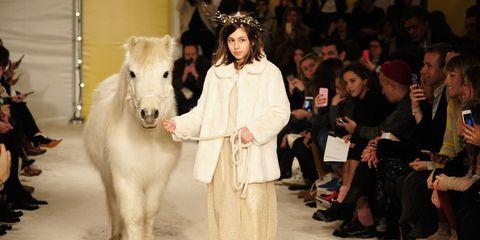 Footwear, Human, Event, Hat, Fashion, Working animal, Horse, Fur, Pony, Runway,