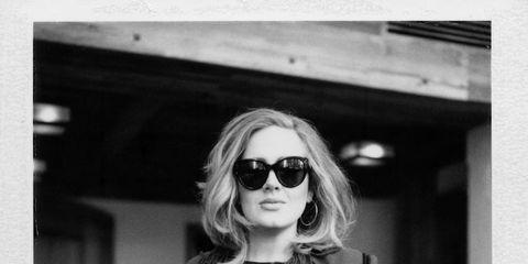 Eyewear, Vision care, Sunglasses, Sleeve, Outerwear, Style, Coat, Dress, Street fashion, Monochrome photography,