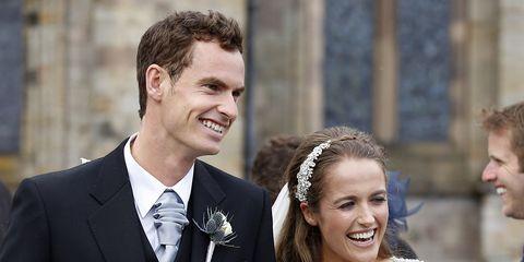 Clothing, Coat, Smile, Dress, Trousers, Petal, Suit, Bridal clothing, Photograph, Bouquet,