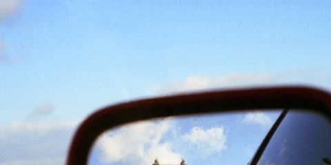 Automotive mirror, Motor vehicle, Mode of transport, Sky, Daytime, Road, Glass, Cloud, Infrastructure, Automotive side-view mirror,