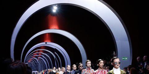 Human body, Event, Outerwear, Dress, Crowd, Fashion, Fashion show, Runway, Fashion model, Tunnel,