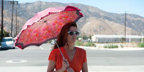 Eyewear, Vision care, Glasses, Road, Umbrella, Shoulder, Red, Sunglasses, Asphalt, T-shirt,