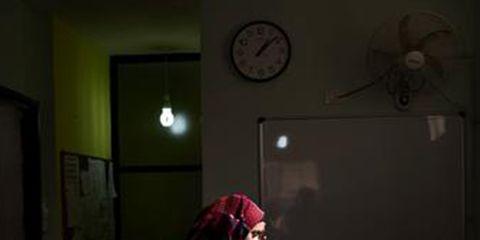 Room, Wall, Headgear, Wall clock, Home accessories, Interior design, Clock, Quartz clock,