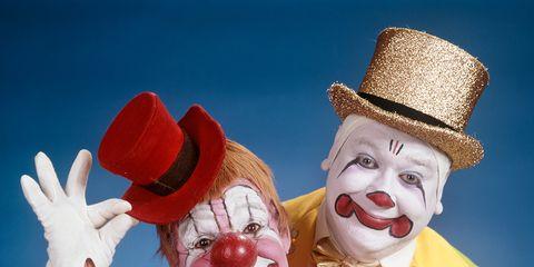 Fun, Performing arts, Entertainment, Clown, Costume, Hat, Costume accessory, Performance, Gesture, Celebrating,