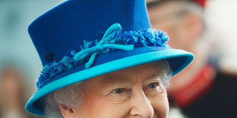 Clothing, Chin, Hat, Outerwear, Happy, Fashion accessory, Facial expression, Electric blue, Headgear, Costume accessory,