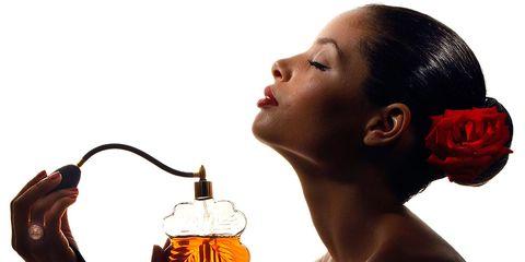 Bottle, Amber, Muscle, Earrings, Body jewelry, Throat, Distilled beverage,