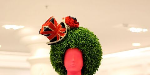 Red, Flower, Costume accessory, Petal, Interior design, Carmine, Cut flowers, Floristry, Flower Arranging, Creative arts,