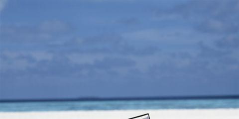 Vacation, Ocean, Summer, Sea, Leisure, Furniture, Travel, Reading, Outdoor furniture, Sitting,
