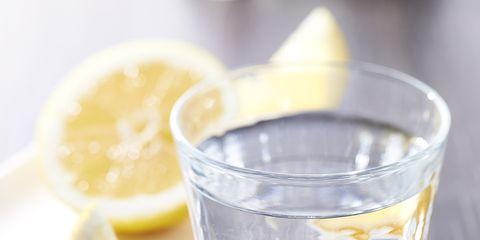 Yellow, Liquid, Lemon, Citrus, Fluid, Glass, Fruit, Tableware, Drink, Logo,