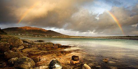Cloud, Coastal and oceanic landforms, Natural landscape, Landscape, Rock, Shore, Coast, Rainbow, Horizon, Sunlight,